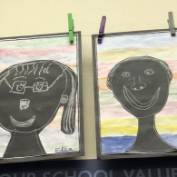 On-our-move-up-day-we-created-portraits-uisng-chalk-with-a-water-colour-background.
